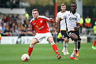 Crewe Alexandre&rsquo;s Matt Tootle gets to the ball ahead of  Port Vale&rsquo;s Jordan Slew. Skybet football league one match, Crewe Alexandra v Port Vale at the Alexandra Stadium in Crewe on Saturday 13th Sept 2014.<br /> pic by Chris Stading, Andrew Orchard sports photography.
