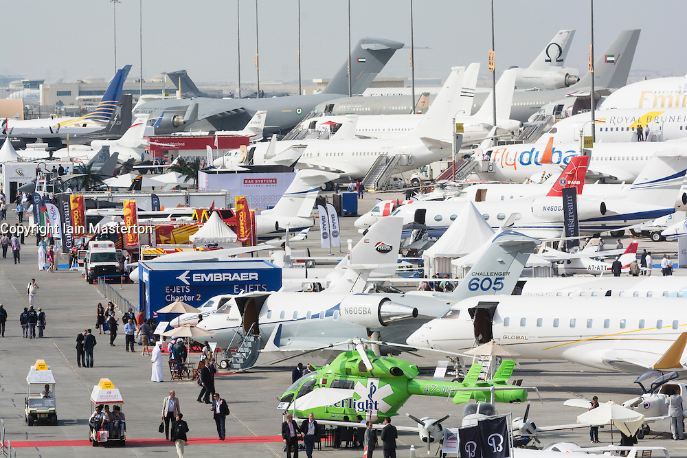 Many civilian and military aircraft on apron at Al Maktoum International airport during Dubai Airshow 2013 in United Arab Emirates