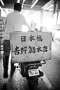 Masatoshi Yoshino buying fish and seafood at Tsukiji Fish Market, Tokyo, Japan