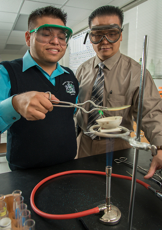 Science teacher Adrian Acosta, left, and Dean of Instruction Jonathan Trinh, right, conducet an experiment at Young Men's College Preparatory Academy, February 3, 2014.