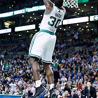 21 December 2012: Boston Celtics power forward Brandon Bass (30) goes for the reverse dunk during the Milwaukee Bucks 99-94 overtime victory over the Boston Celtics at the TD Garden, Boston, Massachusetts, USA.