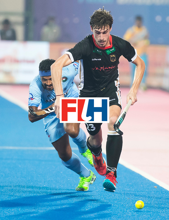 BHUBANESWAR - Hockey World League finals Match for bronze , Germany v India (1-2). Florian Fuchs (Ger) with Birendra Lakra (Ind) COPYRIGHT KOEN SUYK