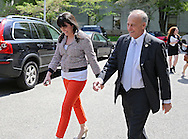 Representative Steve King (R-IA) talks with Brittany Lesser, Communications Director, as they walk outside the Rayburn House Office Building in Washington, DC on Tuesday, April 16, 2013.