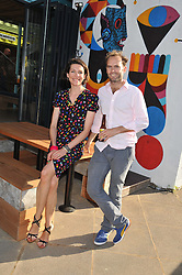 THOMASINA MIERS and MARK SELBY co-owners of Wahaca at a party to celebrate the opening of the Wahaca Southbank Experiment - a temporary restaurant made from 8 metal shipping containers, outside The Queen Elizabeth Hall, Southbank, London SE1 on 28th June 2012.