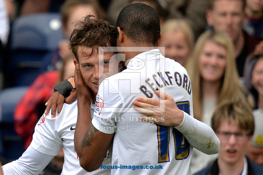 Joe Garner of Preston North End (left) celebrates with Jermaine Beckford of Preston North End after  scoring a penalty to make it Preston North End 2 Chesterfield 0 during the Sky Bet League 1 playoff match at Deepdale, Preston<br /> Picture by Ian Wadkins/Focus Images Ltd +44 7877 568959<br /> 10/05/2015