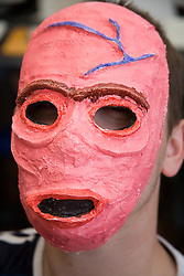 Teenager wearing a mask he has made; Sycamore Centre Nottingham,