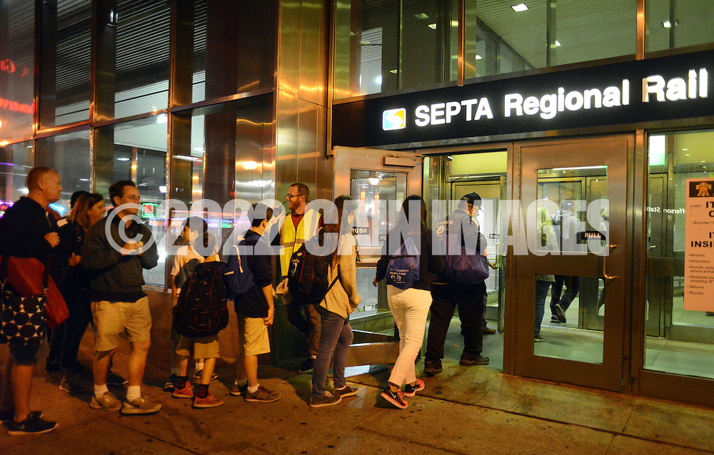 Pilgrims head home to Warminster Station via Septa Regional Rail after the Papal Mass celebrated by Pope Francis Benjamin Franklin Parkway Sunday September 27, 2015 in Philadelphia, Pennsylvania.  (Photo By William Thomas Cain)