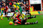 AFC Bournemouth midfielder Charlie Daniels is fouled and wins a penalty during the Barclays Premier League match between Bournemouth and Norwich City at the Goldsands Stadium, Bournemouth, England on 16 January 2016. Photo by Graham Hunt.