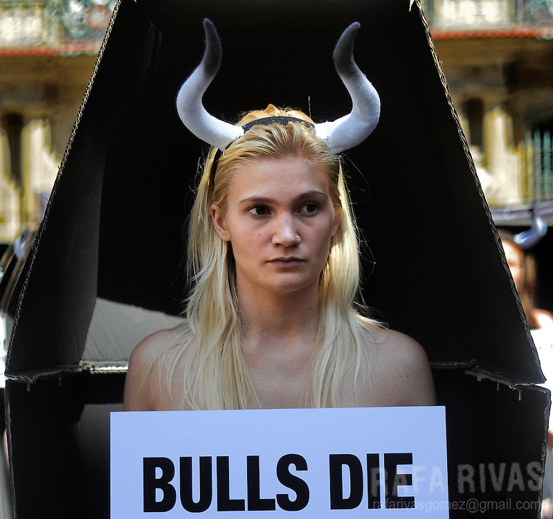 "Activists of PETA and Anima Naturalis pro-animal groups take part in an anti-bullfighting protest standing in coffins that represent the 48 bulls that will be killed during the San Fermin festivities in the Northern Spanish city of Pamplona. Posters read ""Bulls die a bloody death in Pamplona."