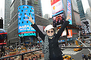 Yoko Ono Lennon appears on the marquee of the Hard Rock Cafe New York, Monday, Nov. 19, 2012, in Times Square, to launch Hard Rock's fifth annual IMAGINE THERE'S NO HUNGER campaign.  Proceeds from the campaign benefit WhyHunger and its grassroots partners combating childhood hunger and poverty worldwide.    (Diane Bondareff/Invision for Hard Rock)