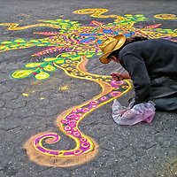 A street artist working with sand of different colors in Union Square. Manhattan, New York City.