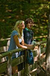 A couple hiking near Arethusa Falls in Crawford Notch State Park in New Hampshire's White Mountains.