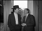 U2 Meet An Taoiseach, Charles Haughey.    (R58)..1987..18.05.1987..05.18.1987..18th May 1987..After their highly successful tour of America, An Taoiseach, Charles Haughey welcomed U2 back to Ireland with a reception held in Iveagh House, Dublin. Iveagh House formerly a home to the Guinness family is now held by the Department of Foreign Affairs...'The Edge' Dave Evans and An Taoiseach, Charles Haughey, are pictured in conversation at the Iveagh House reception.