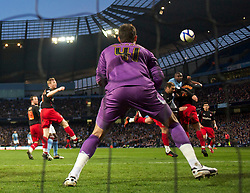 MANCHESTER, ENGLAND - Sunday, March 13, 2011: Reading's Alex McCarthy is beaten by the header of Manchester City's Micah Richards for the only goal of the game during the FA Cup 6th Round match at the City of Manchester Stadium. (Photo by David Rawcliffe/Propaganda)