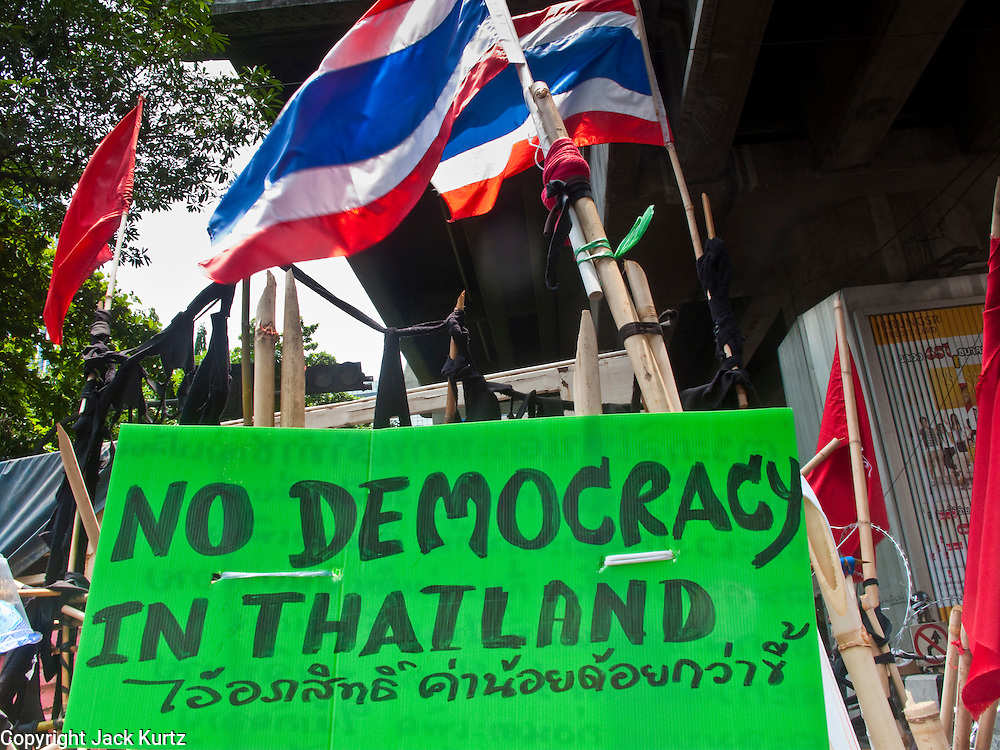 11 MAY 2010 -- BANGKOK, THAILAND: A sign on Chit Lom at the entrance to the Red Shirts encampment. The Red Shirts are continuing their protests in Bangkok and demanding the dissolution of the Thai parliament and resignation of Thai Prime Minister Abhisit Vejjajiva.  PHOTO BY JACK KURTZ