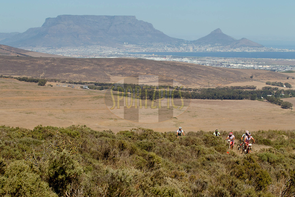 A group of riders walk and cycle up the final hill during the Prologue of the 2012 Absa Cape Epic Mountain Bike stage race held at Meerendal Wine Estate in Durbanville outside Cape Town, South Africa on the 25 March 2012..Photo by Greg Beadle/Cape Epic/SPORTZPICS