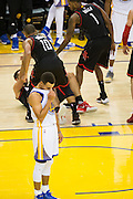 Golden State Warriors guard Stephen Curry (30) reacts after receiving a foul late in the game against the Houston Rockets at Oracle Arena in Oakland, Calif., on December 1, 2016. (Stan Olszewski/Special to S.F. Examiner)
