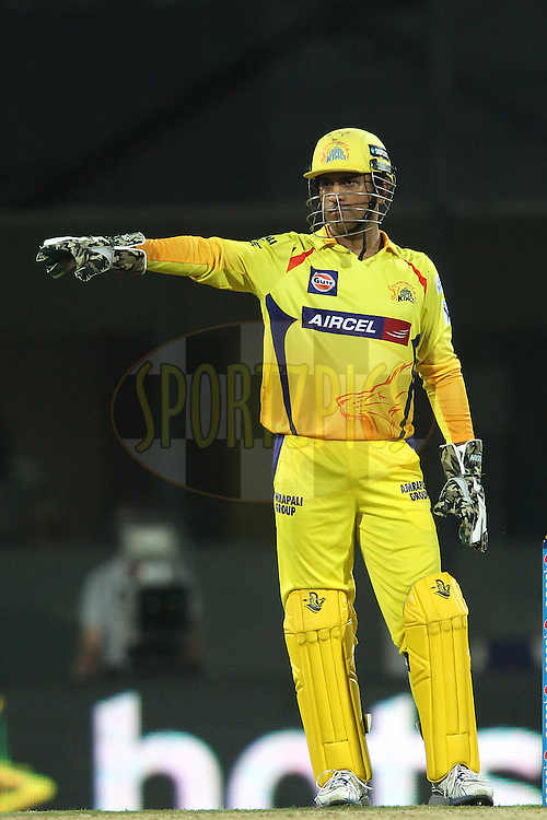 Chennai Super Kings Captain MS Dhoni sets the field during match 37 of the Pepsi IPL 2015 (Indian Premier League) between The Chennai Superkings and The Royal Challengers Bangalore held at the M. A. Chidambaram Stadium, Chennai Stadium in Chennai, India on the 4th May April 2015.<br /> <br /> Photo by:  Shaun Roy / SPORTZPICS / IPL