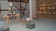 Picture shows the interior of ceremicist Eric Landon's workshop in Kompagnistraede, Copenhagen, Denmark.<br /> 27/05/2013<br /> <br /> Credit should read: Picture by Mark Larner.<br /> <br /> Both a master potter and Designer, Eric is focused on a constant refinement of both form and technique. For him, the one cannot evolve naturally without the other. His love for wheel thrown pottery started already at age 16 and has evolved into a way of life, his vocation. For Eric, shaping objects by hand is not a look back at the past. He firmly believes that hand-crafting objects of a timeless value is a way forward.<br /> <br /> Eric is a graduate of the Danish school of Design in Copenhagen and has been awarded with a number of grants, international exhibition selections, and other distinguishments for the quality of his work.<br /> http://www.tortus-copenhagen.com