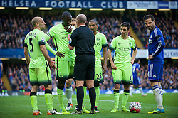 LONDON, ENGLAND - Saturday, April 16, 2016: Referee Mike Dean explains to Manchester City's Yaya Toure why is isn't sending off Pablo Zabaleta and lets him off without a second yellow card during the Premier League match against Chelsea at Stamford Bridge. (Pic by Kirsten Holst/Propaganda)