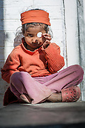 Girl with coin (Nepal)