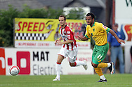 London - Saturday August 15th, 2009: Simon Whaley (R) of Norwich City in action against Ryan Harley of Exeter City during the Coca Cola League One match at St James Park, Exeter. (Pic by Mark Chapman/Focus Images)