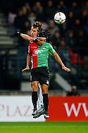17-01-2016 VOETBAL:NEC NIJMEGEN-WILLEM II:NIJMEGEN<br /> Stijn Wuytens van Willem II in duel met Navarone Foor van NEC Nijmegen <br /> <br /> <br /> Foto: Geert van Erven