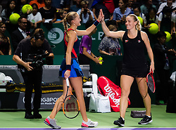 October 26, 2018 - Kallang, SINGAPORE - Kristina Mladenovic of France & Timea Babos of Hungary celebrate winning their doubles quarterfinal match at the 2018 WTA Finals tennis tournament (Credit Image: © AFP7 via ZUMA Wire)