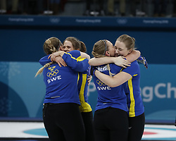February 25, 2018 - Pyeongchang, KOREA - Sweden players including Anna Hasselborg, Sara McManus, Agnes Knochenhauer and Sofia Mabergs celebrate after the women's curling gold medal game during the Pyeongchang 2018 Olympic Winter Games at Gangneung Curling Centre (Credit Image: © David McIntyre via ZUMA Wire)
