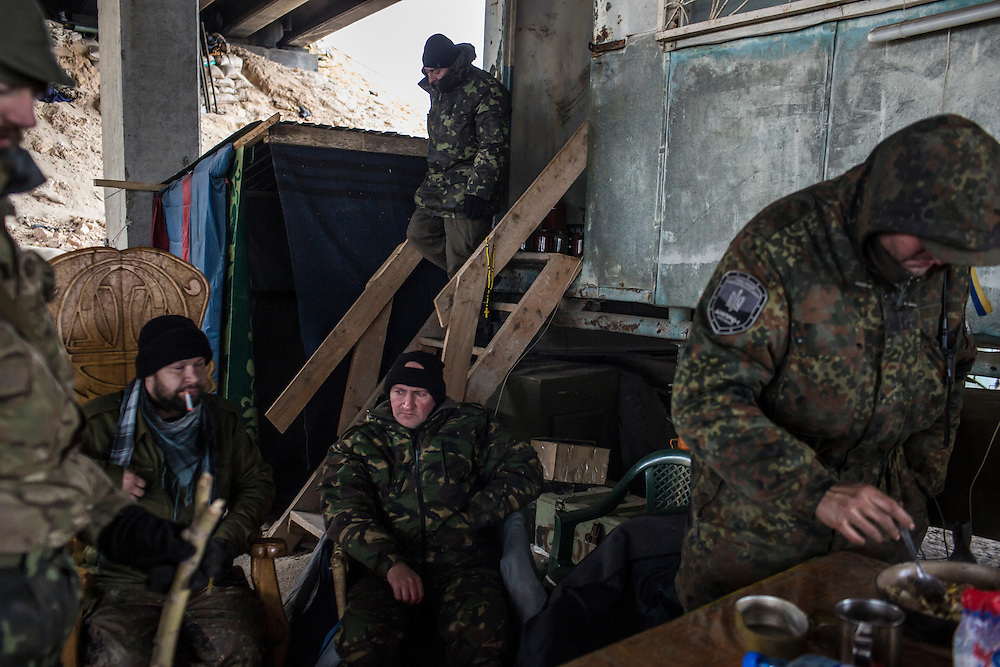 PERVOMAISKE, UKRAINE - NOVEMBER 17, 2014: Members of the 5th platoon of the Dnipro-1 brigade, a pro-Ukraine militia, at their post underneath a bridge in Pervomaiske, Ukraine. CREDIT: Brendan Hoffman for The New York Times
