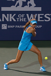 July 27, 2011; Stanford, CA, USA;  Daniela Hantuchova (SVK) returns the ball against Maria Sharapova (RUS), not pictured, during the second round of the Bank of the West Classic women's tennis tournament at the Taube Family Tennis Stadium. Sharapova defeated Hantuchova 6-2, 2-6, 6-4.