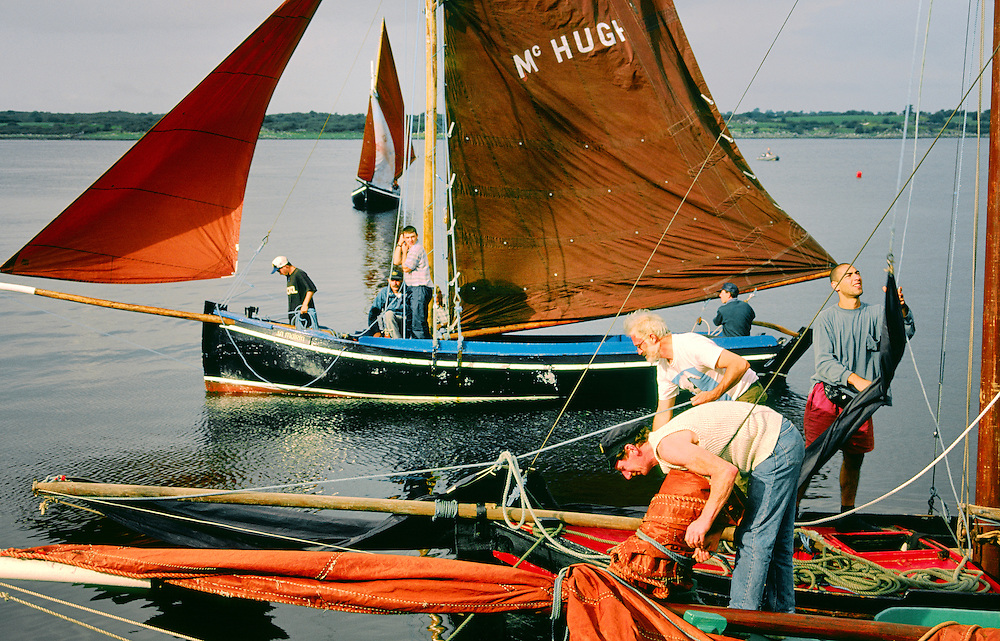 County Galway, Ireland. Traditional red sails fishing boats known as a Galway Bay hooker. Annual sailing festival at Kinvara