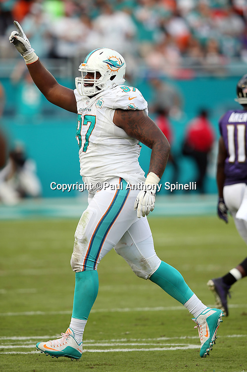 Miami Dolphins defensive tackle Jordan Phillips (97) points during the 2015 week 13 regular season NFL football game against the Baltimore Ravens on Sunday, Dec. 6, 2015 in Miami Gardens, Fla. The Dolphins won the game 15-13. (©Paul Anthony Spinelli)