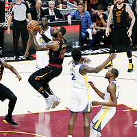 CLEVELAND, OH - JUN 3: LeBron James #23 of the Cleveland Cavaliers goes for the layup past Jordan Bell #2 of the Golden State Warriors in Game Three of the 2018 NBA Finals won 110-102 by the Golden State Warriors over the Cleveland Cavaliers at the Quicken Loans Arena on June 6, 2018 in Cleveland, Ohio. NOTE TO USER: User expressly acknowledges and agrees that, by downloading and or using this photograph, User is consenting to the terms and conditions of the Getty Images License Agreement. Mandatory Copyright Notice: Copyright 2018 NBAE (Photo by Chris Elise/NBAE via Getty Images)