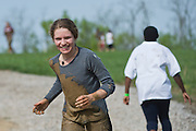 A participant runs down the hill after completing the old Army ROTC training course located at the Ridges during the O'Bleness Race for a Reason Mud Run, Saturday, April 27, 2013. The course included a four-mile run up to the old Army ROTC Course at the Ridges, through the Radar Hill Trail and back to Tail Great Park across from Peden Stadium. Race for a Reason, Race 4 A Reason, Annual Events, Events, Students, Faculty & Staff