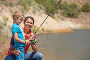 Mother smiling while  fishing with son Lower Goose Creek Reservoir near Oakley, Idaho.