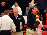 4 FEB. 2010 -- WEBSTER GROVES, Mo. --  Parkway West head basketball coach Bill Sodemann (right) acknowledges the crowd after accepting a plaque honoring his retirement at the end of the season before the game Thursday, Feb. 4, 2010 between Webster Groves and Parkway West at Webster Groves High School. Photo (c) copyright by Sid Hastings.