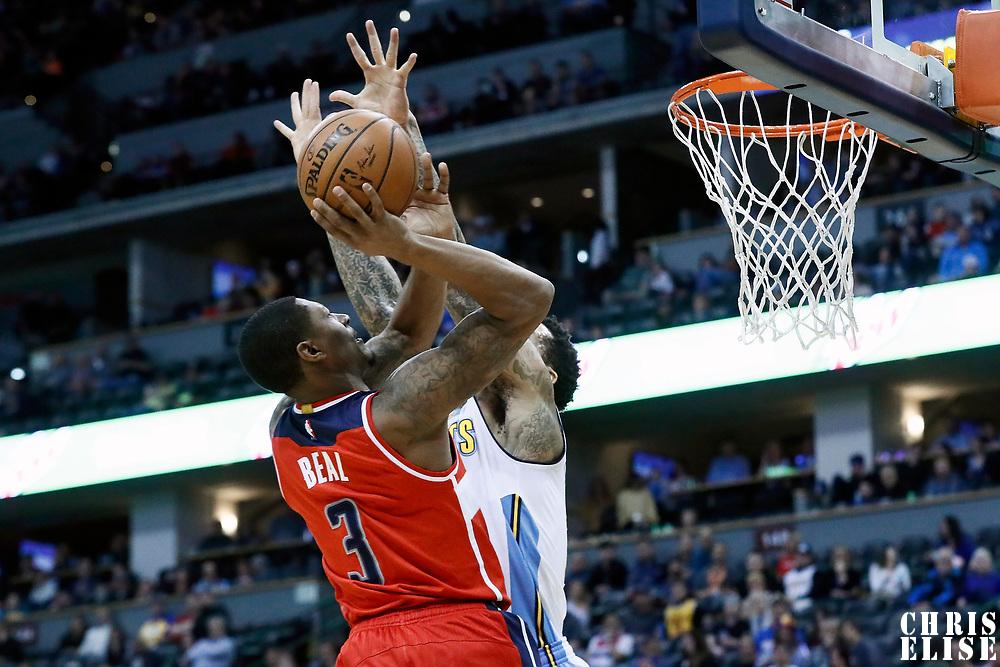08 March 2017: Washington Wizards guard Bradley Beal (3) goes to the basket against Denver Nuggets forward Wilson Chandler (21) during the Washington Wizards 123-113 victory over the Denver Nuggets, at the Pepsi Center, Denver, Colorado, USA.