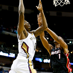 Oct 23, 2013; New Orleans, LA, USA; New Orleans Pelicans small forward Al-Farouq Aminu (0) shoots over Miami Heat power forward Chris Bosh (1) during the first half of a preseason game at New Orleans Arena. Mandatory Credit: Derick E. Hingle-USA TODAY Sports