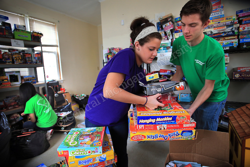 Katherine Jabboury, of Troy, and Tod Carnish, of Mentor, OH, work together to sort sports and game donations in an area of the house. They were among eleven CMU students volunteering during her Alternative Break at the Carolina Youth Development Center in North Charleston, SC, spending the week to help with projects to improve the center and in the community.  CMU is ranked fourth in the nation for the number of students participating in Alternative Breaks and fifth in the country for the most trips coordinated by a university. The program organizes about 40 trips each year with more than 400 students participating. Photo by Steve Jessmore/Central Michigan University