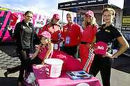 Pink Girls with HiQ Breast Cancer care hats with HiQ Rushden's Paul Evans and his Daughter Demi.