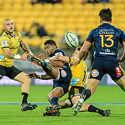 Waisake Naholo tackled by Beauden Barrett during the super rugby union  game between Hurricanes  and Highlanders, played at Westpac Stadium, Wellington, New Zealand on 24 March 2018.  Hurricanes won 29-12.
