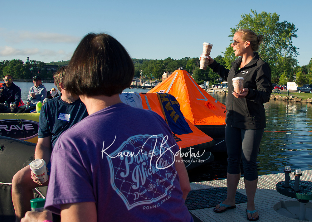 """First order of the day """"coffee"""" delivered to rafters by volunteer Alison Milioto Saturday morning during Rafting for Wishes with Make A Wish at Hesky Park and Meredith Bay.  (Karen Bobotas/for the Laconia Daily Sun)"""