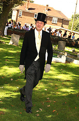 Comedian STEPHEN FRY at the wedding of musician Jools Holland to Lady Crystabel Durham held at Cooling Village Church, Cooling, Kent on 30th August 2005.<br /><br />NON EXCLUSIVE - WORLD RIGHTS