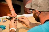 Montana State Hemp and Cannabis Festival, Lolo Hot Springs, Montana, rolling marijuana joint