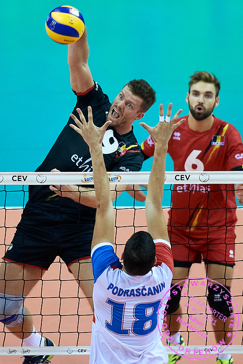 Poland, Krakow - 2017 September 03: Pieter Verhees from Belgium spikes against Marko Podrascanin from Serbia while Third Place match between Belgium and Serbia during LOTTO EUROVOLLEY POLAND 2017 - European Championships in volleyball  at Tauron Arena on September 03, 2017 in Krakow, Poland.<br /> <br /> Mandatory credit:<br /> Photo by &copy; Adam Nurkiewicz<br /> <br /> Adam Nurkiewicz declares that he has no rights to the image of people at the photographs of his authorship.<br /> <br /> Picture also available in RAW (NEF) or TIFF format on special request.<br /> <br /> Any editorial, commercial or promotional use requires written permission from the author of image.