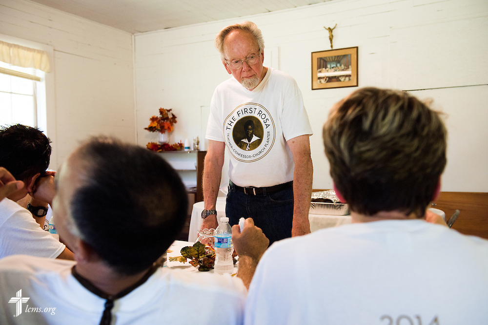 Director Dr. Ardon Albrecht consults with his film crew during lunch at 'The First Rosa' filming on Wednesday, Sept. 24, 2014, at Hope Lutheran Church outside Selma, Ala. LCMS Communications/Erik M. Lunsford