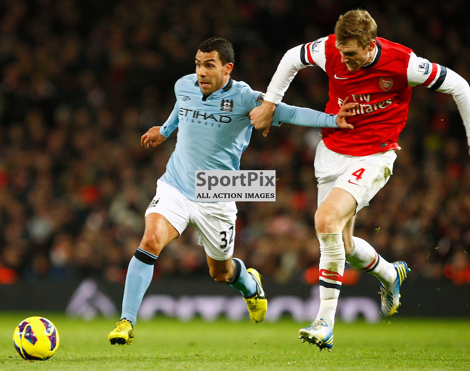 Carlos Tevez fighting off Per Mertesacker (c) MATT BRISTOW | StockPix.eu