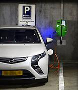 Nederland, Nijmegen, 30-12-2013In een parkeergarage staat een opel ampera aan de oplaadunit.Foto: Flip Franssen/Hollandse Hoogte