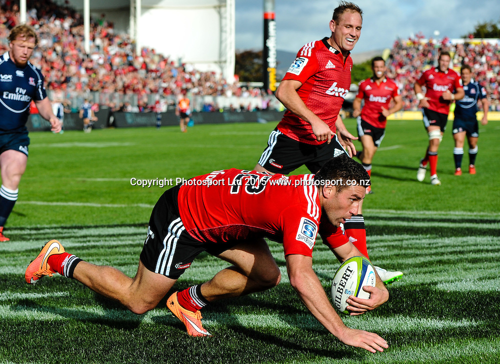 Andy Ellis watches as Kieron Fonotia of the Crusaders scores a try during the Super Rugby match: Crusaders v Lions at AMI Stadium, Christchurch, New Zealand, 14 March 2015. Copyright Photo: John Davidson / www.Photosport.co.nz